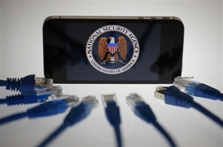 An illustration picture shows the logo of the U.S. National Security Agency on the display of an iPhone in Berlin NSA